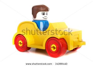 stock-photo-toy-car-with-driver-over-white-background-with-lots-of-copyspace-the-car-has-slight-shadows-to-34388440